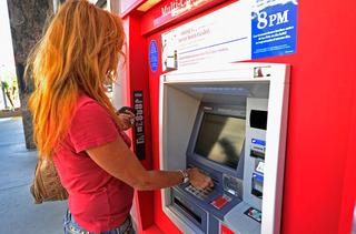 Debit card suprise drains woman's bank account