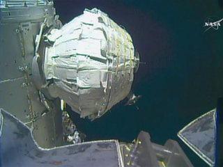 Spacewalking astronauts install new front door