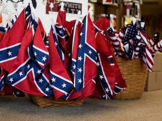 Activist wants people to burn Confederate flags
