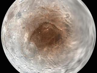 Pluto 'spray-painting' poles of its big moon