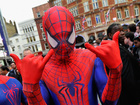 Superheroes wash windows at children's hospital