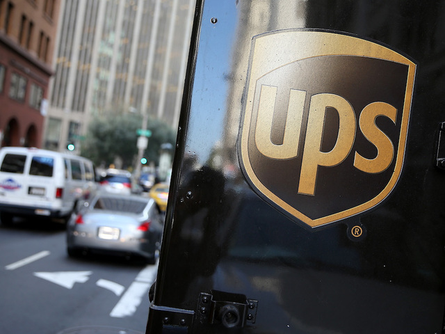 Police in standoff with suspect in UPS driver's shooting