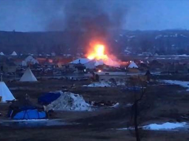 Dakota Pipeline Protesters Pray, Set Fires Ahead Of Camp Closing