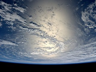 A disco ball-like satellite is orbiting Earth