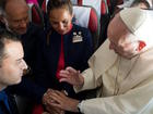 Pope Francis marries couple on plane