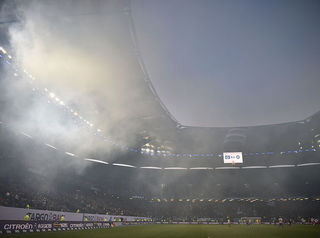 Fans at German soccer stadium disrupt match