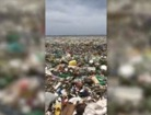 Beach in DR covered in trash