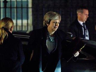 UK delays key Brexit vote